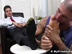 'Handsome businessman relaxes while having his feet worshiped'