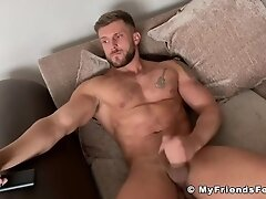 'Barefoot muscle hunk Ryan Yule wanking big cock for camera'