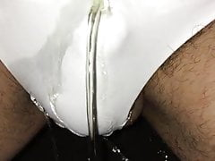 Pissing outdoors in white satin panties