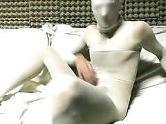 YOUNG GUY IN WHITE PANTYHOSE ENCASEMENT MASTURBATING