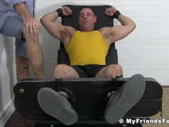 Muscular hunk enjoys getting dominated and tickled on feet