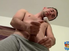 Tattooed straight thug rubs his dick while on the phone solo