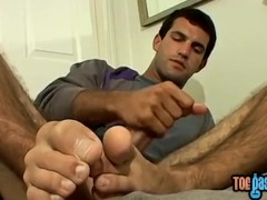 Feet fetish stud tugging his fat cock and coming hard